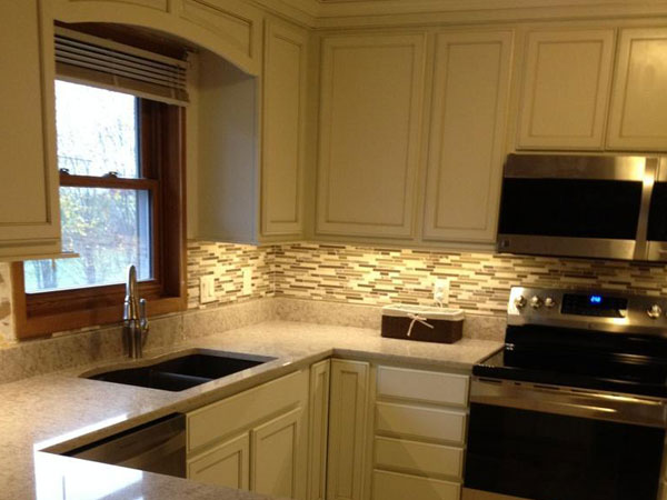 Kitchen remodeling including counter, cabinets, flooring, and backsplash