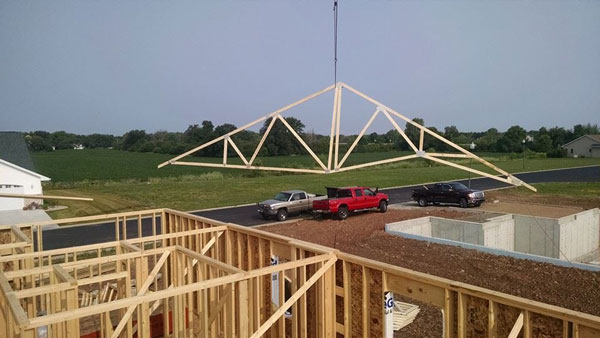 Trusses being added on a new home construction project
